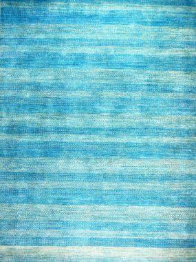 Trendy blauw karpet of vloerkleed. Verkrijgbaar in winkels Didam Tilburg Wolvega Oldenzaal Voorschoten. Mooi in woonkamer of eetkamer.