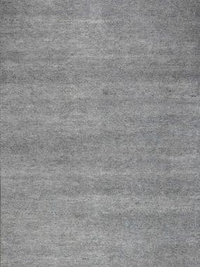 Uni of effe grijs handgemaakt neutraal karpet Buth met beige franjes.