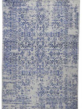Modern wollen grijs tapijt met blauw vintage dessin is verkrijgbaar in Breda Tilburg Wolvega en Arnhem. Mooi in moderne woonkamer.