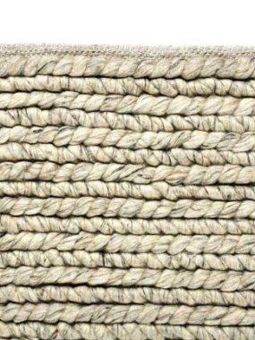 Dik geweven wollen wit en grijs zacht vloerkleed.