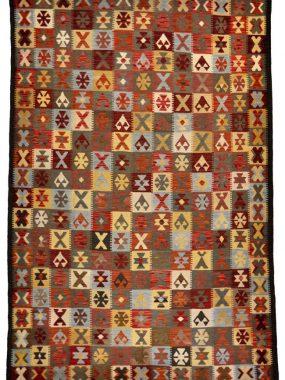 Handgeweven Kelim tapijt van wol en vintage dessin in kleur rood oranje en beige. Perez winkels: Voorschoten Tilburg en Wolvega en Breda