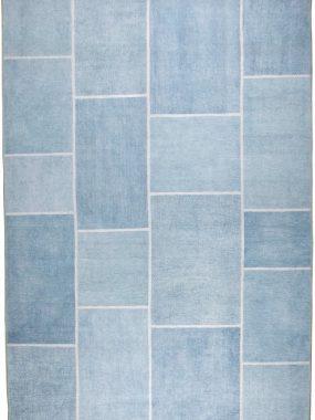 Geprint blauw patch tapijt uit de stijlgroep Vintage & Patch. Past in elk interieur en verkrijgbaar in Tilburg, Den Haag en Arnhem