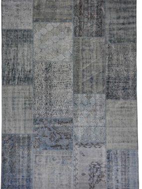 Patch vloerkleed met vintage blauwe en beige kleuren. Te koop in onze vloerkledenwinkels: Tilburg Doetinchem Leiden Hogeveen en Oldenzaal