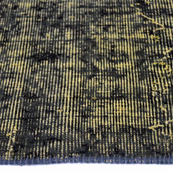 Vloerkleed Adana geel zwart zijkant