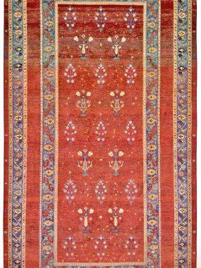 rood handgeknoopt tapijt Lori is verkrijgbaar bij Perez vloerkleden