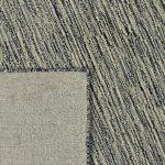 Detail achterkant van grijs groen vloerkleed van wol en viscose. Verkrijgbaar bij Perez vloerkleden in Tilburg.